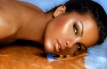Beautiful model sinking in golden substance.