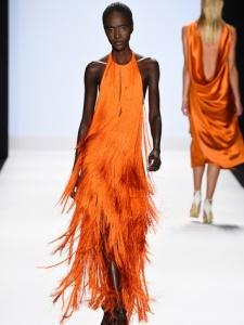 fashion-week-spring-2015-project-runway-model-in-orange-fringe-dress_073555
