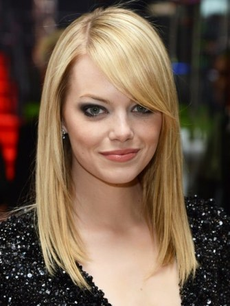 hair-ideas-2012-08-hairstyles-with-bangs-emma-stone-long-side-swept-bangs