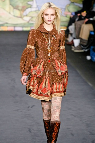 Natasha Poly walks the runway in a cocoa paisley sparkles border print crepe-de-chine blouse, and cocoa paisley spakles border print crepe-de-chine quilted skirt, at the Anna Sui Fall 2010 fashion show, during Mercedes-Benz Fashion Week Fall 2010.