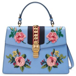 808724cdbfa8 All major designers of purses produce satchel bags, including Coach, Prada,  Guess, Marc Jacobs, DKNY, Mulberry and Calvin Klein, to name a few.
